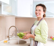 Young Woman Washing Dishes Stock Photos