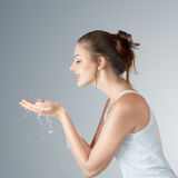 Young woman washing face Stock Image
