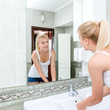 Young woman washing face Royalty Free Stock Photography