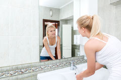 Young woman washing face Stock Photography