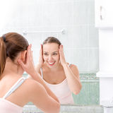 Young woman washing face Stock Photos