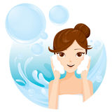Young woman washing face with foam Royalty Free Stock Image