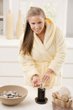 Young woman washing hands Stock Images