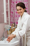 Young woman washing hands in bathroom Royalty Free Stock Photo