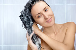 Young Woman Washing Head By Shampoo Stock Photography
