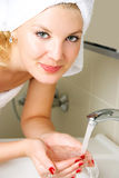 Young woman washing her face Royalty Free Stock Photos