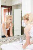 Young woman washing her face Stock Photography