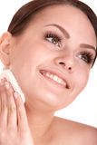 Young woman washing her face by sponge. Royalty Free Stock Photography