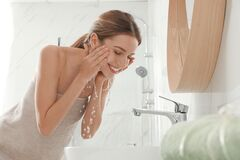Free Young Woman Washing Her Face With Water In Bathroom Stock Images - 205481784