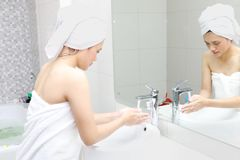 Young woman washing her hands after bathing Royalty Free Stock Image