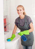 Young woman washing sink Royalty Free Stock Photos