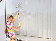 Young woman washing the window stock photos