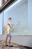 Young woman washing the window Royalty Free Stock Photo