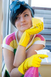 Woman window wash. Young woman washing windows in the flat Stock Photo