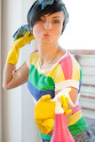 Spring Clean out. Young woman washing windows in the flat Stock Photo