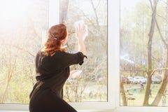 Young woman washing windows stock photos