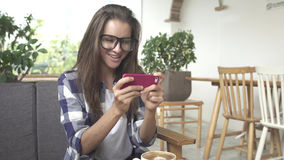 Young woman watch movie on smartphone Royalty Free Stock Photos