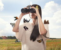 Young woman watching with binocular stock photos