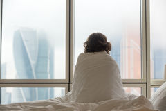 Young woman watching city view in the morning Royalty Free Stock Images