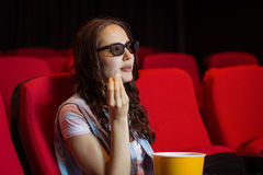 Young woman watching a 3d film Stock Images