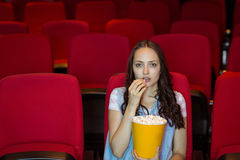 Young woman watching a film Royalty Free Stock Photography