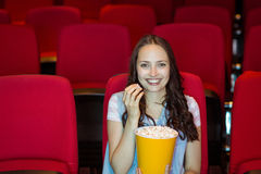 Young woman watching a film Royalty Free Stock Images