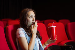 Young woman watching a film Stock Images