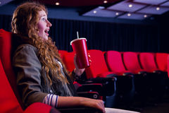 Young woman watching a film Stock Photography