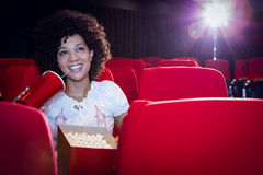 Young woman watching a film and drinking a soda Stock Image