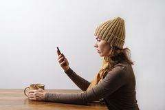 Young woman watching her smartphone Stock Photos