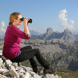 Young woman watching the landscape in the mountains Stock Photos