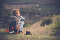 Young woman watching landscape, posing outdoor. royalty free stock image