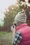 Young woman watching landscape, posing outdoor. Royalty Free Stock Photography