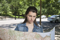 Young woman watching map Royalty Free Stock Photography
