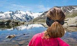 Young woman watching mountain lake Royalty Free Stock Photography