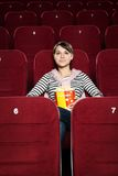 Young woman watching a movie Royalty Free Stock Photos
