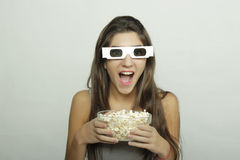 Young woman watching a movie. Cinema concept Royalty Free Stock Photo