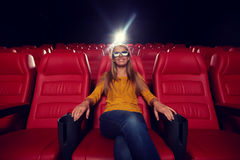 Young woman watching movie in 3d theater Stock Image