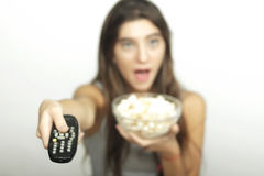 Young woman watching a movie over grey background. Stock Photography