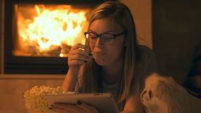 Young woman watching movie with popcorn stock footage