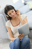 Young woman watching movie on tablet at home Royalty Free Stock Photos