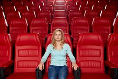 Young woman watching movie in theater Royalty Free Stock Photography