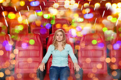 Young woman watching movie in theater Royalty Free Stock Images