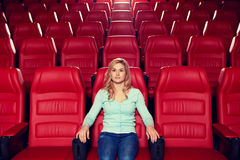 Young woman watching movie in theater Stock Images