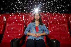 Young woman watching movie in theater Royalty Free Stock Image