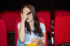 Young woman watching a scary 3d film Royalty Free Stock Image
