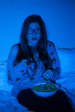 Young woman watching scary movie Royalty Free Stock Images