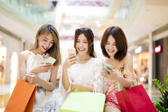 young woman  watching smart phone in shopping mall Royalty Free Stock Image