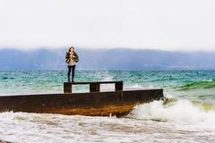 Young woman watching storm over lake. Geneva, Switzerland Royalty Free Stock Image