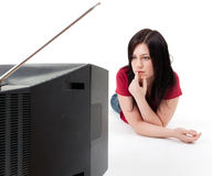 Young woman watching television Royalty Free Stock Photography